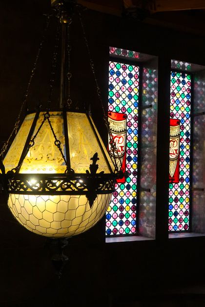 Lantern with Stained Glass in background at Palau Guell
